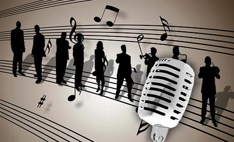 The band silhouetted on sheet music with a microphone in the foreground